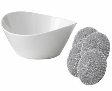 A white porcelain bowl is cleaned clearly by galvanized steel scrubbers.